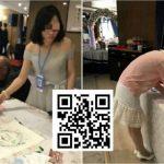 Kody QR w Chinach. Kobieta zbierająca datki dla nowożeńców z wykorzystaniem kodu QR.